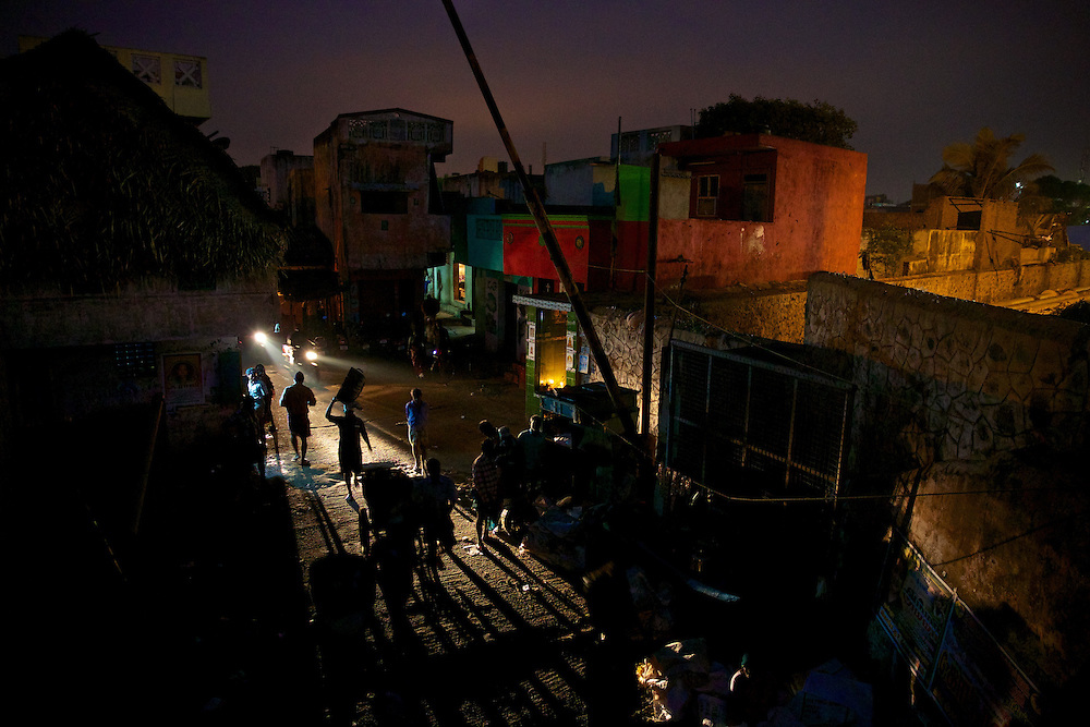 People in market place at night, elevated view, India In Chennai, Kasimedu fishing harbour on Tuesday, December 10, 2012. (Gianluca Colla) Every day hundreds of millions of people in India wake up at dawn and work hard until sunset to find their way out of poverty. Many of these people cannot access clean water and electricity, nor pay school fees for their children or see a doctor when they are sick. Their basic needs have been largely unmet, neither by public services nor by the market that doesn't consider them as potential customers. Access to health care services in India by low-income people is limited due to the poor supply from the public service, especially in remote areas such as slums.