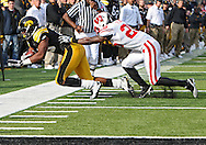October 23 2010: Iowa Hawkeyes wide receiver Derrell Johnson-Koulianos (15) is chased by Wisconsin Badgers cornerback Antonio Fenelus (26) during the first half of the NCAA football game between the Wisconsin Badgers and the Iowa Hawkeyes at Kinnick Stadium in Iowa City, Iowa on Saturday October 23, 2010. Wisconsin defeated Iowa 31-30.