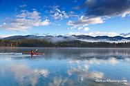 Kayaking on Beaver Lake in autumn at the Stillwater State forest near Whitefish, Montana, USA  MR
