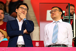 Wolverhampton Wanderers Chairman Jeff Shi (right) with his co-owners from Fonsun International - Mandatory by-line: Robbie Stephenson/JMP - 25/07/2018 - FOOTBALL - Bet365 Stadium - Stoke-on-Trent, England - Stoke City v Wolverhampton Wanderers - Pre-season friendly