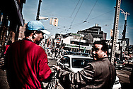 Chinese men chatting on the street at Chinatown, Toronto, Canada