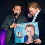 NLD/Amsterdam/20181206 - CD Trots presentatie Wesly Bronkhorst, cd overhandigd door komiek Najib Amhali