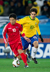 Hong Yong Jo of North Korea vs Kaka of Brazil during the 2010 FIFA World Cup South Africa Group G match between Brazil and North Korea at Ellis Park Stadium on June 15, 2010 in Johannesburg, South Africa. Brazil defeated Korea 2-1. (Photo by Vid Ponikvar / Sportida)