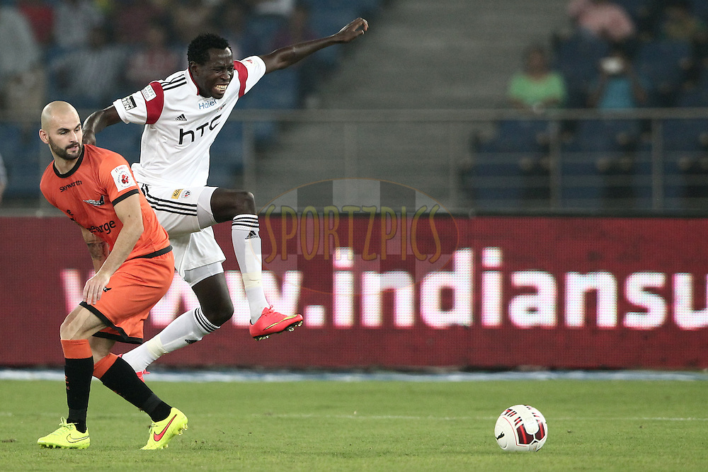 Hans Mulder of Delhi Dynamos FC , Kondwani Mtonga of NorthEast United FC in action during match 16 of the Hero Indian Super League between The Delhi Dynamos FC and NorthEast United FC held at the Jawaharlal Nehru Stadium, Delhi, India on the 29th October 2014.<br /> <br /> Photo by:  Deepak Malik/ ISL/ SPORTZPICS