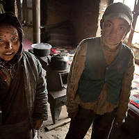 A tibetan woman Sango of 42 and her son Dorchi-Thinley of 13, are affected by the Kashin-Beck Disease, in the small community of Narme, in the Lhasa river valley. The infected ones get to lose their capacity to work, and normally they live in the poverty.. Tibet, China. April 14, 2007. Photo: Bernardo De Niz