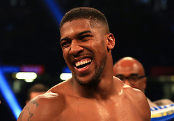 Anthony Joshua celebrates victory over Carlos Takam during the IBF World Heavyweight Title, IBO World Heavyweight Title and WBA Super World Heavyweight Title bout at the Principality Stadium, Cardiff.
