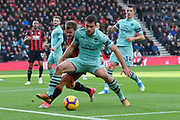 Sokratis Papastathopoulos (5) of Arsenal shields the ball from Ryan Fraser (24) of AFC Bournemouth during the Premier League match between Bournemouth and Arsenal at the Vitality Stadium, Bournemouth, England on 25 November 2018.
