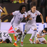 EAST RUTHERFORD, NEW JERSEY - JUNE 17: Colombia players react to their sides penalty shoot out win  during the Colombia Vs Peru Quarterfinal match of the Copa America Centenario USA 2016 Tournament at MetLife Stadium on June 17, 2016 in East Rutherford, New Jersey. (Photo by Tim Clayton/Corbis via Getty Images)