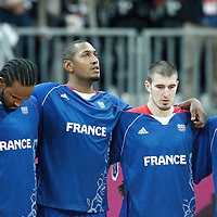 04 August 2012: Ronny Turiaf, Boris Diaw, Nando De Colo and Yannick Bokolo are seen during the National Anthem prior to the 73-69 Team France victory over Team Tunisia, during the men's basketball preliminary, at the Basketball Arena, in London, Great Britain.