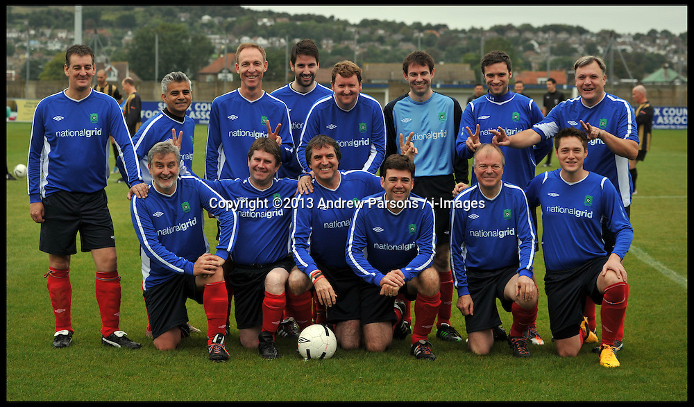 The Labour team pose for a team picture and make the same hand gestures as The Prime Minister got while posing for a picture with the British Loins team as the  Labour Politicians v Reporter's Football match at the Labour Party Autumn Conference take place . Sunday, 22nd September 2013. Picture by Andrew Parsons / i-Images