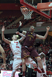 11 January 2014:  Nick Zeisloft and Cody Johnson spread eagle trying to avoid contact but get rebound position as a long ball drops through the hoop during an NCAA  mens basketball game between the Ramblers of Loyola University and the Illinois State Redbirds  in Redbird Arena, Normal IL.  Redbirds win 59-50
