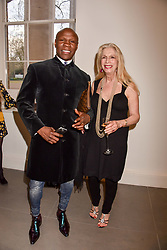 Chris Eubank and Lady Colin Campbell at a preview of the 'From Selfie To Self-Expression' exhibition at The Saatchi Gallery, Duke Of York's HQ, King's Road, London, England. 30 March 2017.