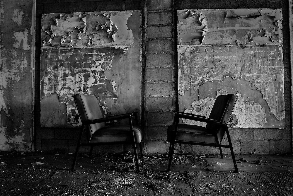 Two chairs face each other in an abandoned building in downtown Gary, Indiana. Gary's population peaked in the early 1960s at roughly 174,000 residents but has fallen to around 80,000 according to the latest U.S. Census in 2010. In addition to the collapsing infrastructure and deteriorating buildings, the number of abandoned houses is sharply increasing as people leave the city. (© William B. Plowman/Redux)