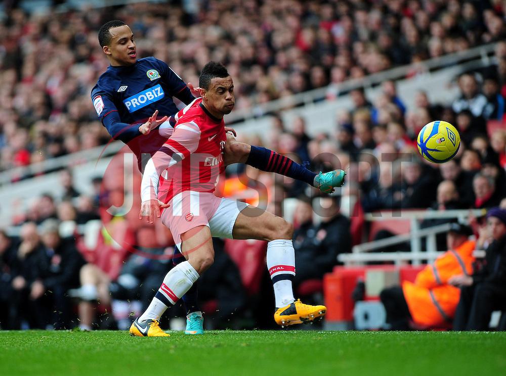 Arsenal's Francis Coquelin shields the ball from Blackburn Rovers' Marcus Olsson  - Photo mandatory by-line: Dougie Allward/JMP - Tel: Mobile: 07966 386802 16/02/2013 - SPORT - FOOTBALL - Emirates Stadium - London -  Arsenal V Blackburn Rovers - FA Cup - Fifth Round