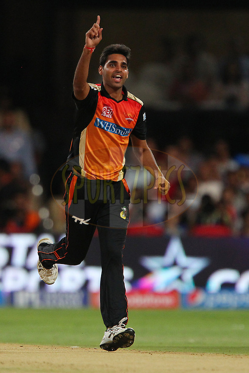 Bhuvneshwar Kumar of the Sunrisers Hyderabad celebrates the wicket of Parthiv Patel of the Royal Challengers Bangalore during match 24 of the Pepsi Indian Premier League Season 2014 between the Royal Challengers Bangalore and the Sunrisers Hyderabad held at the M. Chinnaswamy Stadium, Bangalore, India on the 4th May  2014<br /> <br /> Photo by Ron Gaunt / IPL / SPORTZPICS<br /> <br /> <br /> <br /> Image use subject to terms and conditions which can be found here:  http://sportzpics.photoshelter.com/gallery/Pepsi-IPL-Image-terms-and-conditions/G00004VW1IVJ.gB0/C0000TScjhBM6ikg