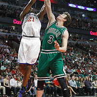 17 March 2012: Philadelphia Sixers forward Thaddeus Young (21) goes to the basket over Chicago Bulls center Omer Asik (3) during the Chicago Bulls 89-80 victory over the Philadelphia Sixers at the United Center, Chicago, Illinois, USA.