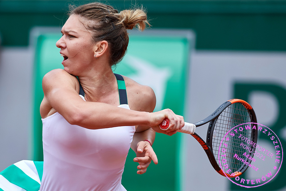 Paris, France - 2017 June 03: Simona Halep from Romania plays a forehand while her women's single match third round during tennis Grand Slam tournament The French Open 2017 (also called Roland Garros) at Stade Roland Garros on June 03, 2017 in Paris, France.<br /> <br /> Mandatory credit:<br /> Photo by &copy; Adam Nurkiewicz<br /> <br /> Adam Nurkiewicz declares that he has no rights to the image of people at the photographs of his authorship.<br /> <br /> Picture also available in RAW (NEF) or TIFF format on special request.<br /> <br /> Any editorial, commercial or promotional use requires written permission from the author of image.