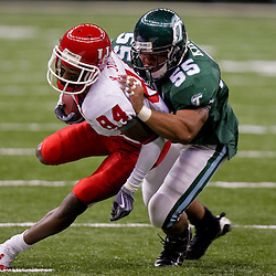 Oct 17, 2009; New Orleans, LA, USA; Houston Cougars wide receiver Kierrie Johnson (84) is tackled by Tulane Green Wave linebacker David Kirksey (55) at the Louisiana Superdome. Houston defeated Tulane 44-16. Mandatory Credit: Derick E. Hingle-US PRESSWIRE