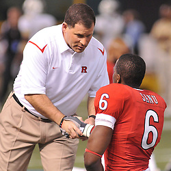 Dec 19, 2009; St. Petersburg, Fla., USA; Rutgers head coach Greg Schiano shakes hands with wide receiver Mohamed Sanu (6) during warmups for NCAA Football action in Rutgers' 45-24 victory over Central Florida in the St. Petersburg Bowl at Tropicana Field.