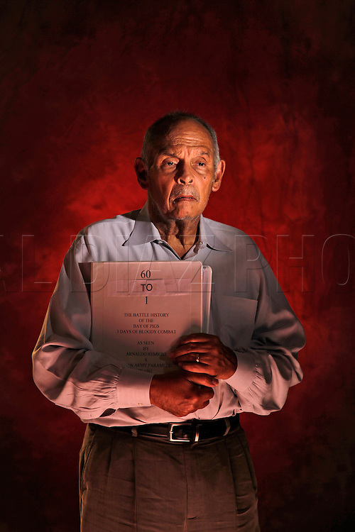 Arnaldo Remigio, holds a manuscript of his book 60 to 1. It tells the story of his involvement during the Bay of Pigs on the side of Cuban Armed Forces under Fidel Castro.