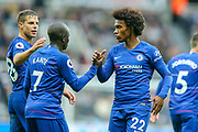 Willian (#22) of Chelsea celebrates with Ngolo Kante (#7) of Chelsea as Chelsea retake the lead through an own goal (1-2) during the Premier League match between Newcastle United and Chelsea at St. James's Park, Newcastle, England on 26 August 2018.