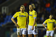 Kalvin Phillips (23) of Leeds United and Luke Ayling (2)  of Leeds United during the EFL Sky Bet Championship match between Reading and Leeds United at the Madejski Stadium, Reading, England on 12 March 2019.