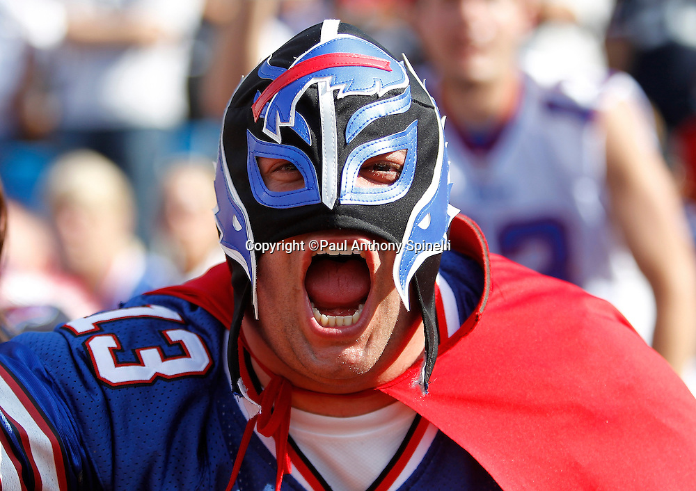 A Buffalo Bills fan with a cape and a mask cheers during the NFL week 3 football game against the New England Patriots on Sunday, September 25, 2011 in Orchard Park, New York. The Bills won the game 34-31. ©Paul Anthony Spinelli