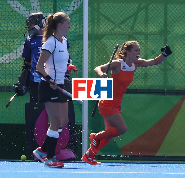 RIO DE JANEIRO, BRAZIL - AUGUST 13:  Xan de Waard of the Netherlands celebrates after scoring a goal during the Women's group A hockey match between the Netherlands and Germany on Day 8 of the Rio 2016 Olympic Games at the Olympic Hockey Centre on August 13, 2016 in Rio de Janeiro, Brazil.  (Photo by David Rogers/Getty Images)
