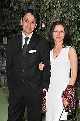 Managing Director Cartier UK FRANCOIS LE TROQUER and his wife LIUDMILA at a dinner hosted by Cartier in celebration of the Chelsea Flower Show held at Battersea Power Station, 188 Kirtling Street, London SW8 on 23rd May 2011.