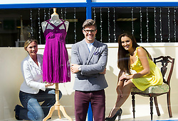 Repro Free: 03/09/2013 Stylist Darren Kennedy shows BT employee Anne Keirse (left) and model Holly Carpenter what frugal fashion you can find in your local charity shop to launch the first ever, all-Ireland, Great BT Charity Shops Challenge with the Irish Cancer Society and Marie Curie Cancer Care.  The event sees over 170 BT Ireland staff take over the running of a charity shop on Thursday 3rd October. Remember our charity shops ~ Volunteer ~ Shop ~ Donate.  Visit www.cancer.ie/shops Picture Andres Poveda