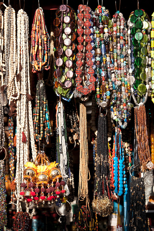 Beads and necklaces on market stall in street scene in city of Varanasi, Benares, Northern India
