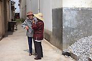 Villagers catch up in Xizhou village, north of Dali.