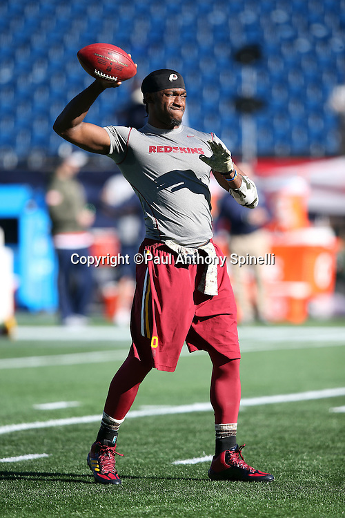 Washington Redskins quarterback Robert Griffin III (10) throws a pregame pass while warming up before the 2015 week 9 regular season NFL football game against the New England Patriots on Sunday, Nov. 8, 2015 in Foxborough, Mass. The Patriots won the game 27-10. (©Paul Anthony Spinelli)