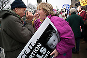 National Organization for Women members along with supporters of a women's right to choose take part in a vigil in front of the Supreme Court in Washington, D.C. on the 39th anniversary of the Roe v. Wade decision.