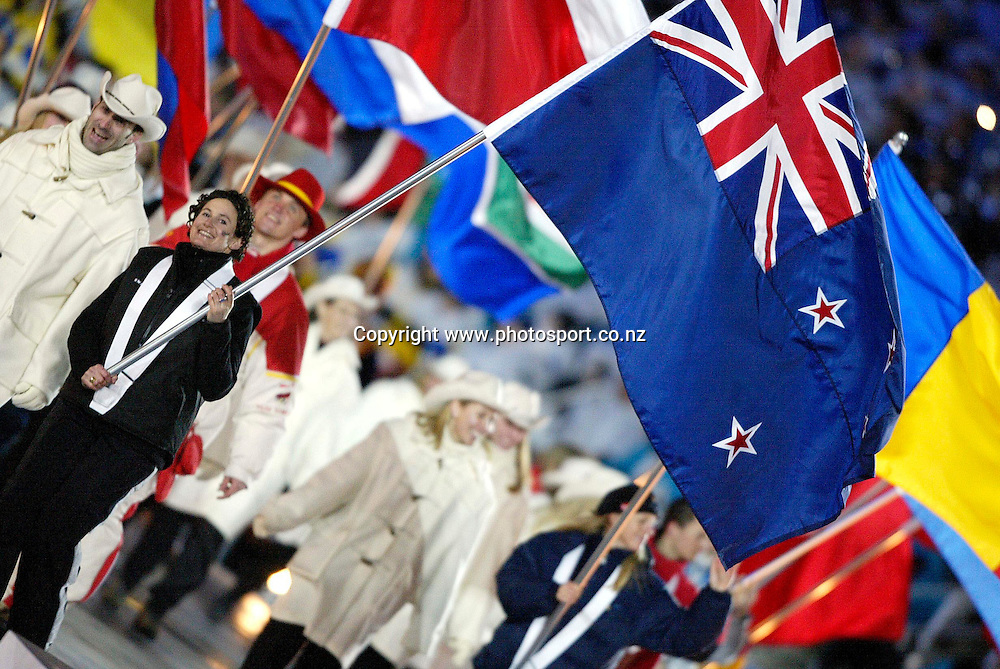 Claudia Reigler (NZL) carries the flag into the stadium as the athletes are farewelled at the closing ceremony of the Winter Olympics, Salt Lake City, Utah,  USA, 24 February 2002. Photo: PHOTOSPORT<br /><br /><br /><br />048033  *** Local Caption ***