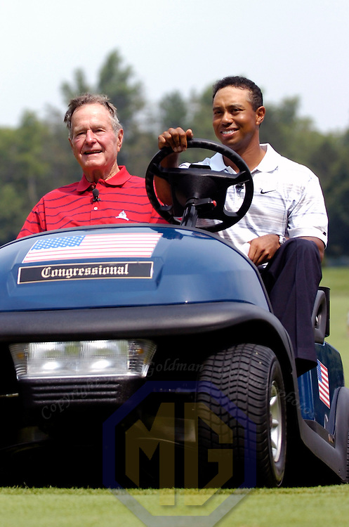 04 July 2007:  Former President George H. W. Bush and Tiger Woods arrive at the first tee to start the inaugural AT&T National PGA event at Congressional Country Club in Bethesda, Md. The proceeds of the golf tournament will benefit the Tiger Woods Foundation and local Washington, DC, based charities.  ****For Editorial Use Only