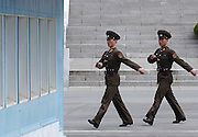 North Korean border guards march along the tense border.