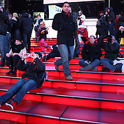 A street scene in Manhattan, New York, as tourists take pictures from the Time Square observatory deck. Manhattan, New York, USA. 26th November 2012. Photo Tim Clayton