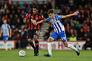 AFC Bournemouth striker Lys Mousset (31) and Brighton and Hove Albion midfielder Jayson Molumby (49) challenge for the ball during the EFL Cup match between Bournemouth and Brighton and Hove Albion at the Vitality Stadium, Bournemouth, England on 19 September 2017. Photo by Adam Rivers.