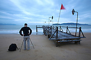 Evason Ana Mandara & Six Senses Spa ? Nha Trang. The jetty. Hobby photographer taking  pictures with his tripod.