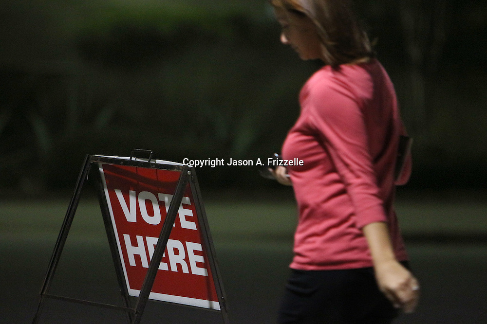 A voter walks into the Carolina Beach Recreation Center in Carolina Beach. (Jason A. Frizzelle)
