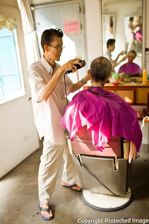 getting a trim at an 80 year barber shop on Jalan Hnag Kasturi
