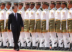 © licensed to London News Pictures. KUALA LUMPUR 28/04/11. Chinese Premier Wen Jiabao inspects a guard of honour at the prime minister's office in Putrajaya outside Kuala Lumpur on April 28, 2011.Wen began a two-day visit to Malaysia to reaffirm relations and boost economic ties between the two countries.. Please see special instructions for usage rates. Photo credit should read Mohd Rasfan/LNP