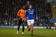 Portsmouth Defender, Christian Burgess (6) holds off Southend United Forward, Theo Robinson (31) during the EFL Sky Bet League 1 match between Portsmouth and Southend United at Fratton Park, Portsmouth, England on 18 November 2017. Photo by Adam Rivers.