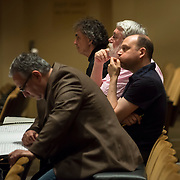 June 3, 2014 - New York, NY : From left, mentor composer Robert Beaser, young composer advocate of the New York Philharmonic Jon Deak, mentor composer Christopher Rouse, and mentor composer Derek Bermel listen as a new composers' work is rehearsed by the New York Philharmonic at Lincoln Center's Avery Fisher Hall on Tuesday. Three works by little-known composers will be selected for inclusion in the New York Philharmonic's Biennial.  CREDIT: Karsten Moran for The New York Times