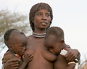 Africa, Ethiopia, Omo River Valley Hamer Tribe woman and babies