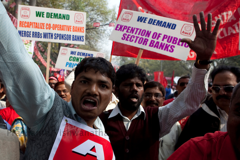 Workers from trade unions across the country shout anti government slogans while on a march to the parliment street protesting against rising food prices, low wages and job security, New Delhi, India, on Wednesday, February 23, 2011. Photographer: Prashanth Vishwanathan/Bloomberg News