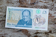 London, England - April 16, 2017: New Plastic Five Pound Note, Went into circulation on September 2016.