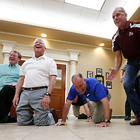 Thomas Wells | Buy at PHOTOS.DJOURNAL.COM<br /> Tupelo Mayor Jason Shelton, from left, Sen. Roger Wicker, Rep. Trent Kelly and Lee County Sheriff Jim Johnson get a quick laugh after completing a 22 push up challenge to bring awareness to veteran sucides.