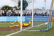 Scott Flinders (goalkeeper) of York City FC is unable to stop Jake Reeves of AFC Wimbledon goal during the Sky Bet League 2 match between AFC Wimbledon and York City at the Cherry Red Records Stadium, Kingston, England on 19 March 2016. Photo by Stuart Butcher.
